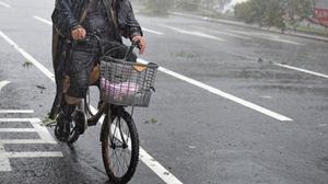 Typhoon Dujuan sweeps people off their feet
