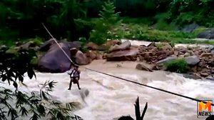 นาทีชีวิต! ชาวบ้าน อ.สิชล โรยตัวด้วยเชือกข้ามคลองกระแสน้ำเชี่ยวกราก