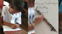 เด็กฟิลิปปินส์ขาดเครื่องเขียน ใช้เศษไม้กับไส้ปากกาผูกติดกันเขียนหนังสือ