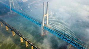 สวยอลัง!! จีนสร้างสะพานแขวนรถไฟฟ้าสายแรกของโลก