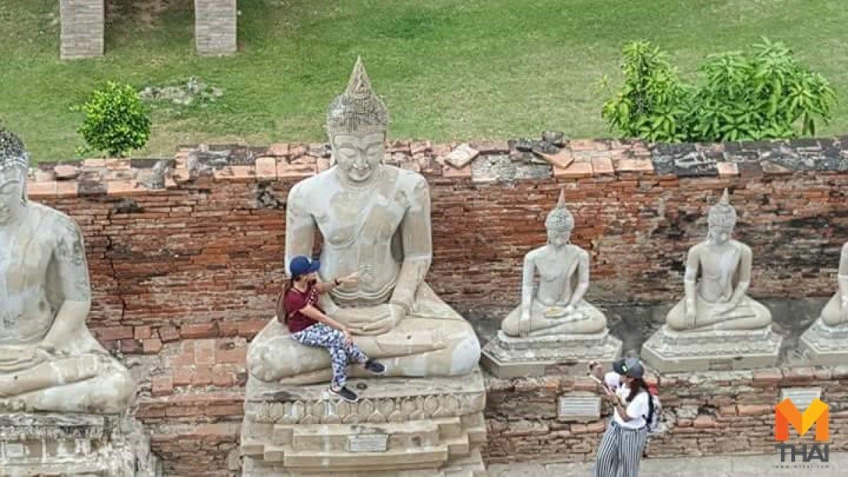 อีกแล้ว!! นักท่องเที่ยวปีนพระพุทธรูป นั่งโพสท่าถ่ายภาพในโบราณสถาน