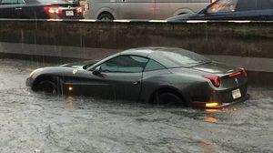 แชร์ว่อน 'เฟอร์รารี่' ฝ่าน้ำท่วม หลังฝนถล่มกรุง เพจดังฟันค่าซ่อมเกิน 2 ล้าน !