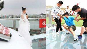 แฟนหนุ่มถอดใจเพราะกลัวความสูง ปล่อยให้เจ้าสาวยืนรอเก้อกลาง สะพานกระจก สูง 30 เมตร