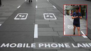 สังคมก้มหน้าถูกใจสิ่งนี้!! เมือง แมนเชสเตอร์ เปิดตัวถนนสำหรับคนที่ชอบเดินเล่นโทรศัพท์