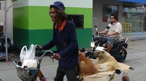 ชายเร่ร่อน พาสุนัขปั่นจักรยานรอบเมืองอ่างทอง สร้างรอยยิ้ม